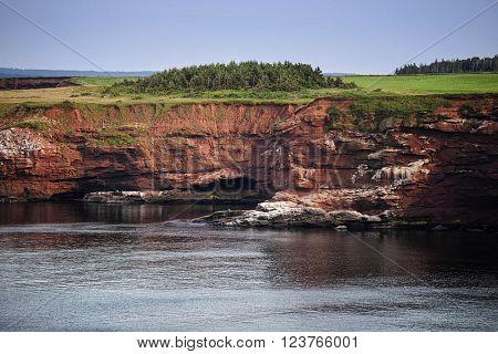 High sandstone cliffs on the north side of Prince Edward Island, Canada