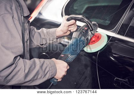 auto mechanic buffing car autobody
