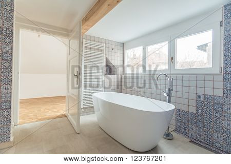 Interior of modern bathroom with free standing bath tub