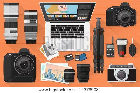 Professional photographer equipment on a desk shooting and photo editing concept flat lay