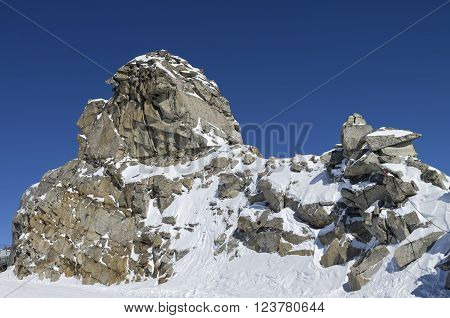 A rock in the shape of a sphinx or other fabulous creature. The top of the Hintertux glacier in the Austrian Alps. Height - 3250 meters above sea level.