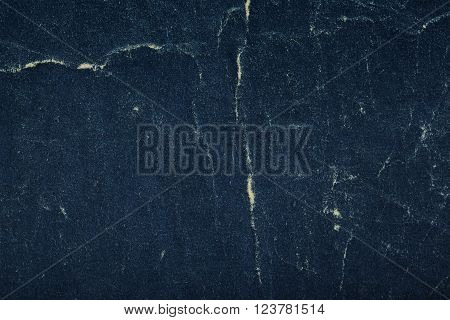 Cracked dark paperboard background with space for text