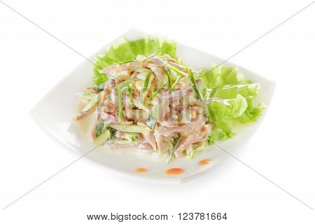 Vegetable salad with ham and mushrooms. Isolated on white background.