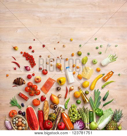 Healthy food background. Studio photo of different fruits and vegetables on wooden table. High resolution product top view.