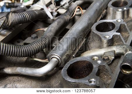 Intake manifold and fuel rail on a car that is being taken apart for repair
