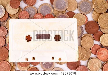 Picture of a Business Money Concept Idea Musicassette Tape and Coin