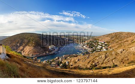 Panorama view of Balaclava from the ancient fortress Chembalo. Balaclava Bay with yachts in bright sunny day. Crimea, Rusiia.