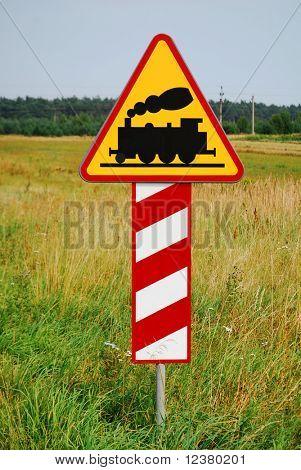 Hazard railway crossing sign ahead. Yellow railroad tracks sign.