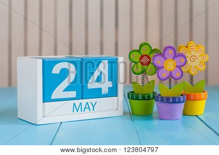 May 24th. Image of may 24 wooden color calendar on white background with flowers. Spring day, empty space for text. The European Day Of Parks, EDoP.