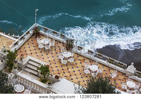 Empty open-air restaurant at Amalfi seacoast Italy