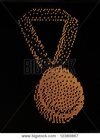 receive a gold medal on a black plate light