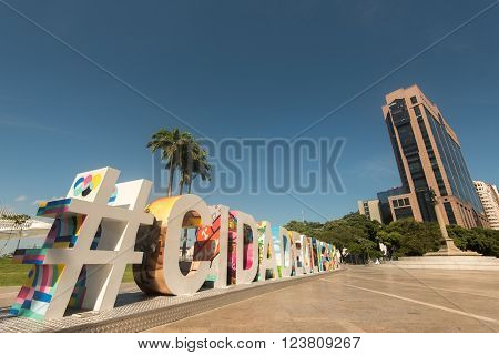 RIO DE JANEIRO, BRAZIL - MARCH 21, 2016: Large colorful sign #CIDADEOLIMPICA (Olympic city) stands in Maua Plaza in the regenerated port area.
