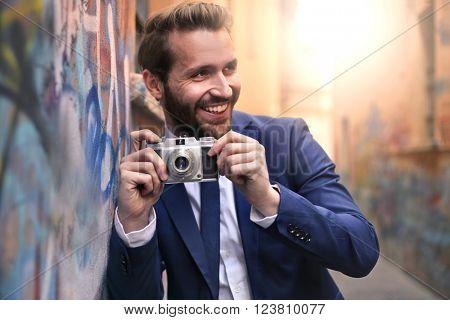 Handsome man with vintage camera