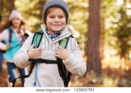 Boy enjoying hike in a forest with family, California, USA
