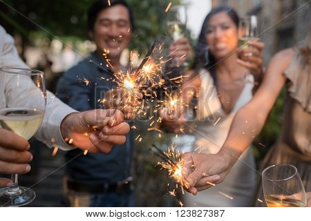 Haooy people at celebration holding glowing sparklers