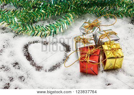 love shape ribbon tree on snow background.