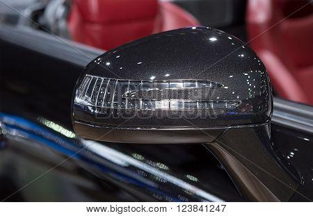 Bangkok - March 22 : wing mirror of black Benz series SLK 200 - in display at The 37th Bangkok international Motor Show 2016 on March 22 2016 in Bangkok Thailand