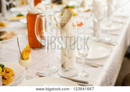Table Served With Different Food And Flatware