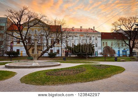 KOSICE, SLOVAKIA - MARCH 19, 2016: Park and historic architecture in the main square of Kosice city in eastern Slovakia on March 19, 2016.