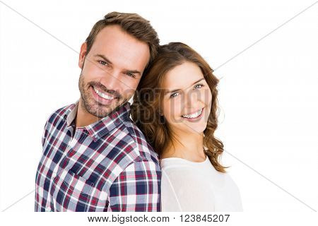 Portrait of happy young couple standing back to back on white back ground