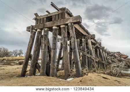 railroad timber trestle destroyed by river flooding - St Vrain Creek near Platteville, Colorado