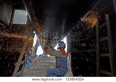 A worker works on the construction of a pipeline