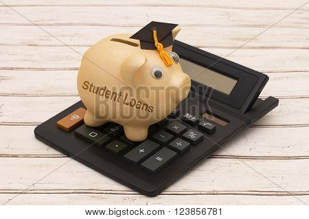 Getting a Student Loans A golden piggy bank with grad cap and calculator on a wood background with text Student Loans poster