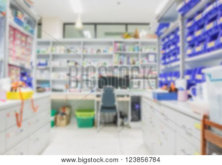 blur background drug shelves in drug store.