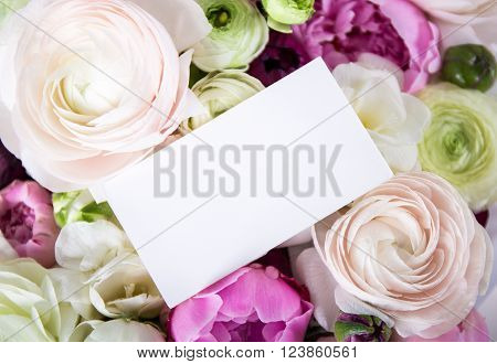 beautiful bunch of summer flowers with blank card