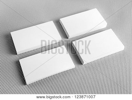 Blank white business cards on gray background. Mockup for branding identity. Blank template for design presentations and portfolios. Template for ID.