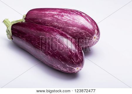 two striped eggplants, aubergine, on white background