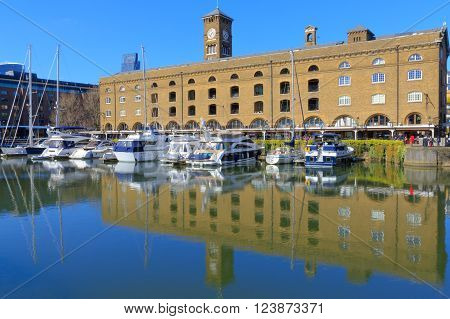 Modern yachts and boat moored at St Katharine dock in London United Kingdom