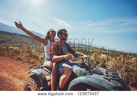Young Couple Enjoying Quad Bike Ride