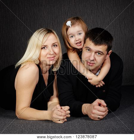 photo of happy family on dark background