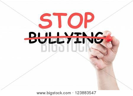 Stop bullying concept text write on transparent wipe board by hand holding a marker