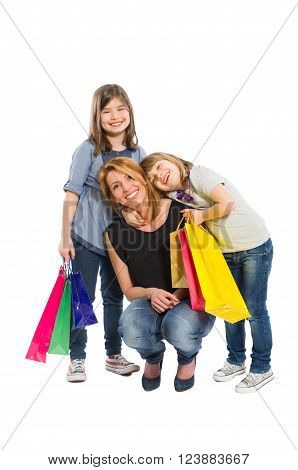 Happy shopping family with mother and two daughters on white background