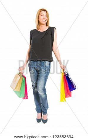 Casual shopping woman wearing casual clothes and carrying shopping bags on white background