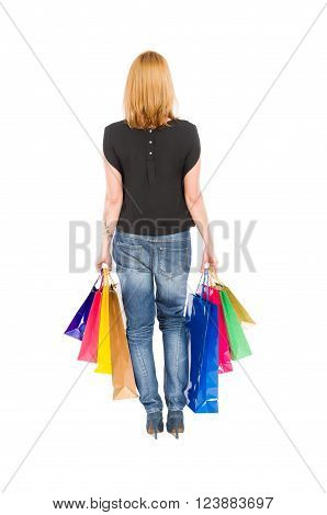 View From Behind Of A Shopping Woman Walking