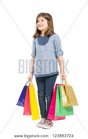 Happy joyful and young shopping girl standing isolated on white background