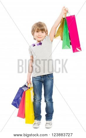 Young shopping girl with shopping bags isolated on white background