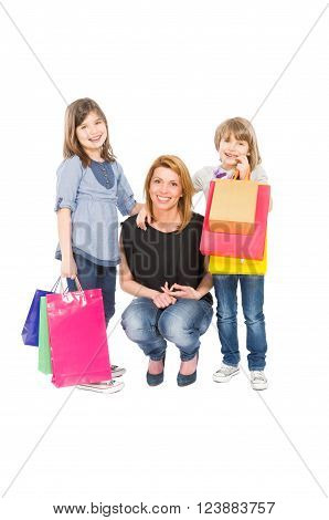 Shopping woman and daughters isolated on white background