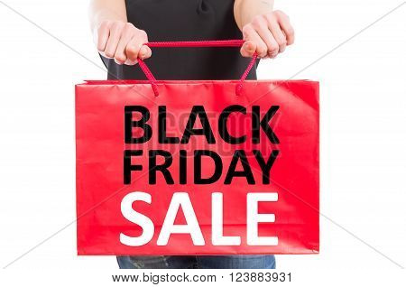 Black Friday concept with a red paper gft bag held a woman hands