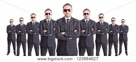 Organized group of business people standing with confidence on wide image
