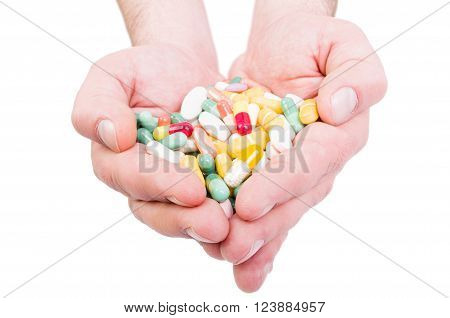 Both Hands Holding Bunch Of Pills