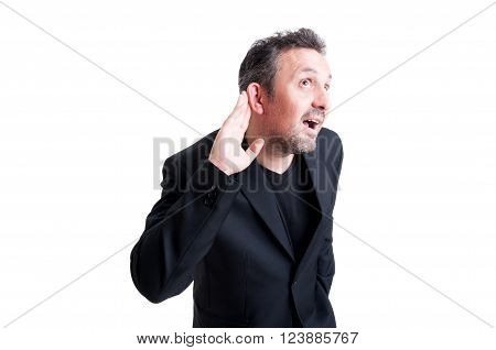 Man making eavesdropping gesture leaning the ear to the camera