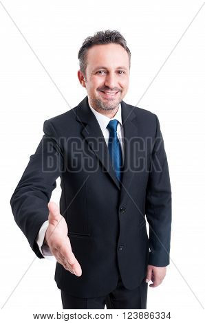 Friendly And Smiling Business Man Leaning For Hand Shake