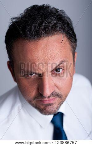 Business Man Lifting One Eyebrow