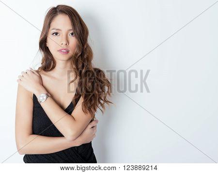 beautiful young asian woman with long hair wearing a wrist watch