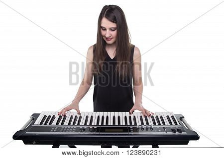 Girl playing on synthesizer on white background