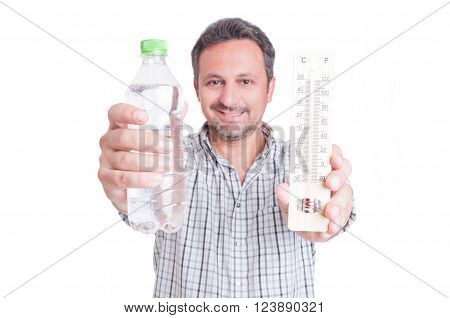 Man holding thermometer and cold water bottle as summer heat and dehydration concept isolated on white